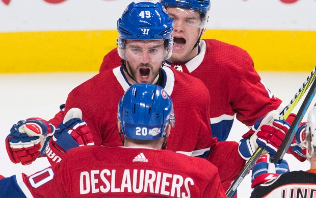 Montreal Canadiens right wing Logan Shaw (49) celebrates with teammate left wing Nicolas Deslauriers (20) after scoring against the Anaheim Ducks during first period NHL hockey action in Montreal, Saturday, February 3, 2018. (THE CANADIAN PRESS/Graham Hughes)