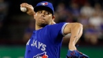 In this June 19, 2017, file photo, Toronto Blue Jays' Roberto Osuna throws to the Texas Rangers in the ninth inning of a baseball game in Arlington, Texas. (Tony Gutierrez/AP Photo)