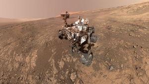 This self-portrait of NASA's Curiosity Mars rover shows the vehicle on Vera Rubin Ridge, which it's been investigating for the past several months. Poking up just behind Curiosity's mast is Mount Sharp, photobombing the robot's selfie. (NASA/JPL-Caltech/MSSS)