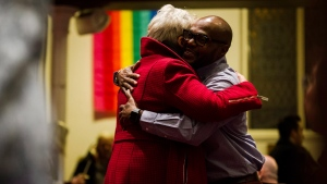 Community members embrace during a vigil hosted by the Metropolitan Community Church of Toronto, in Toronto on Sunday, February 4, 2018.  (THE CANADIAN PRESS/Christopher Katsarov)