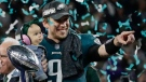 Philadelphia Eagles' Nick Foles holds his daughter, Lily, after beating the New England Patriots in the NFL Super Bowl 52 footballgame Sunday, Feb. 4, 2018, in Minneapolis. (AP Photo/Frank Franklin II)