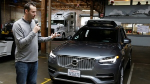 In this photo taken Tuesday, Dec. 13, 2016, file photo, Anthony Levandowski, then-head of Uber's self-driving program, speaks about their driverless car in San Francisco.(AP Photo/Eric Risberg, File)
