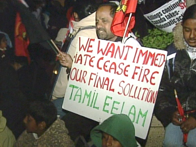 A Tamil protester holds up a sign during a demonstration in Toronto, on Saturday morning, May 16, 2009.