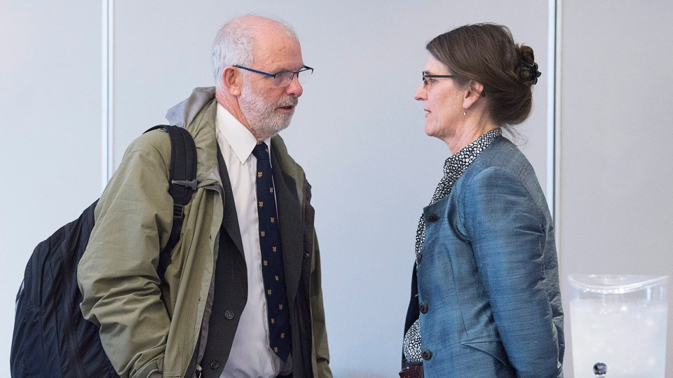 Lawyer Vince Calderhead, left, talks with Claire McNeil, counsel for the Disability Rights Coalition, at a Nova Scotia human rights board of inquiry dealing with persons with disabilities and their attempts to move out of institutions and into small homes, in Halifax on Monday, Feb. 5, 2018.  (THE CANADIAN PRESS/Andrew Vaughan)