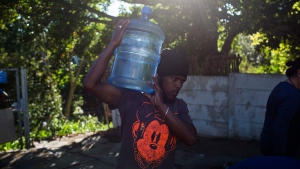 A man carries water in Cape Town