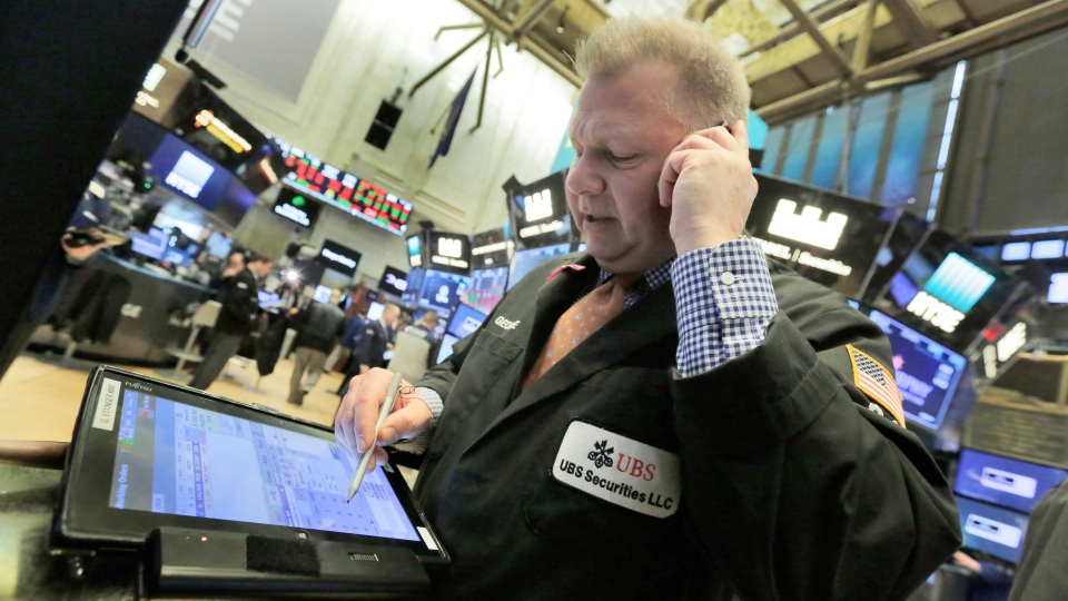Trader George Ettinger works on the floor of the New York Stock Exchange, Monday, Feb. 5, 2018. Stock markets around the world took another pummeling Monday as investors continued to fret over rising U.S. bond yields. (AP Photo/Richard Drew)