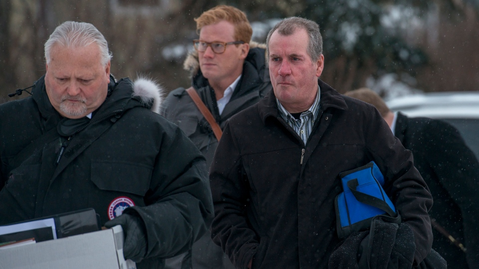 Defence attorney Scott Spencer, left, and his client Gerald Stanley enter the Court of Queen's Bench in Battleford, Sask., on Monday, Feb. 5, 2018, on the fifth day of the evidence at Stanley's trial. THE CANADIAN PRESS/Liam Richards