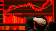 An investor monitors stock prices