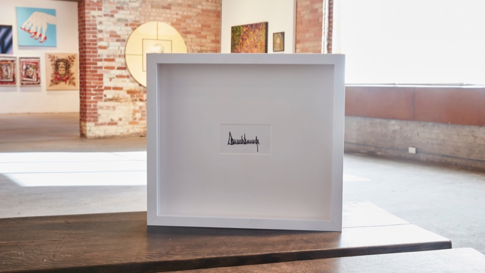 A framed Donald Trump signature is shown at the Only One Gallery in Toronto.