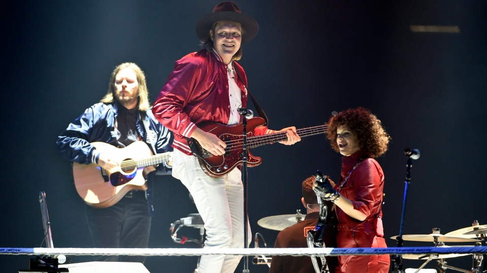 Left to right, Tim Kingsbury, Win Butler and Regine Chassagne of Arcade Fire perform during the band's concert at The Forum on Friday, Oct. 20, 2017, in Inglewood, Calif. (Chris Pizzello / Invision / AP)