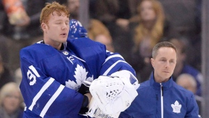 Toronto Maple Leafs goaltender Frederik Andersen (31) is helped off the ice as he leaves the game after being hit during second period NHL hockey action against the Anaheim Ducks in Toronto on Monday, Feb. 5, 2018. THE CANADIAN PRESS/Frank Gunn