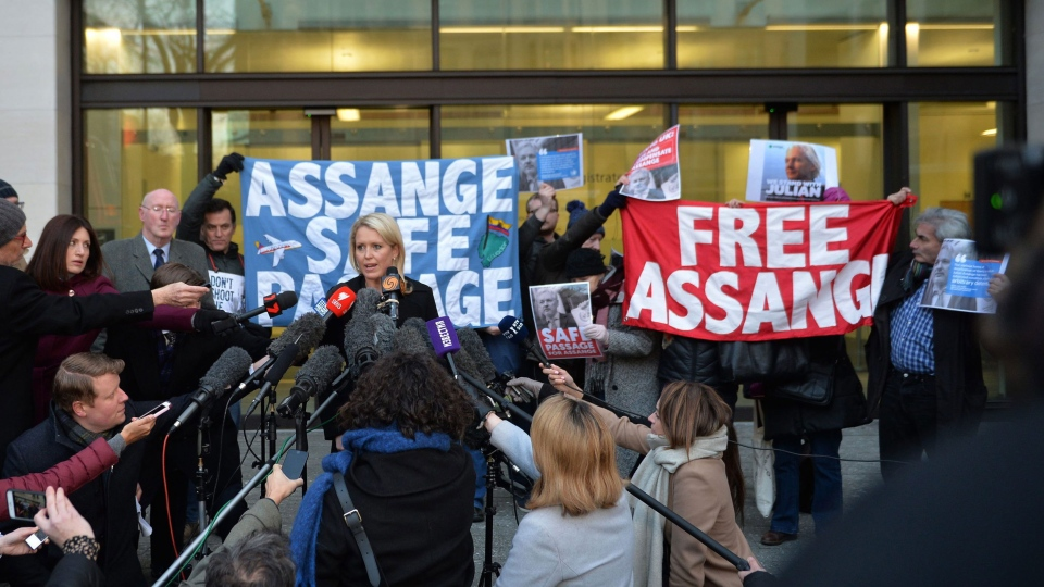 Jennifer Robinson, centre left, a lawyer representing Julian Assange, talks to the media outside Westminster Magistrates Court after the court ruled that an arrest warrant against Assange is still valid, in London, Tuesday Feb. 6, 2018. ( John Stillwell/PA via AP)