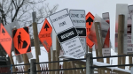 A cluster of road construction signs in Ottawa, Ont.