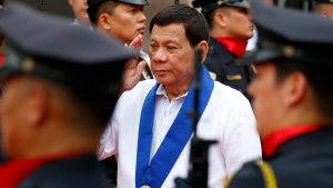 Philippine President Rodrigo Duterte salutes customs police as he arrives to witness the destruction of a fleet of 20 used luxury cars and SUVs as part of the 116th anniversary celebration of the Bureau of Customs in Manila, Philippines Tuesday, Feb. 6, 2018. (AP Photo / Bullit Marquez)