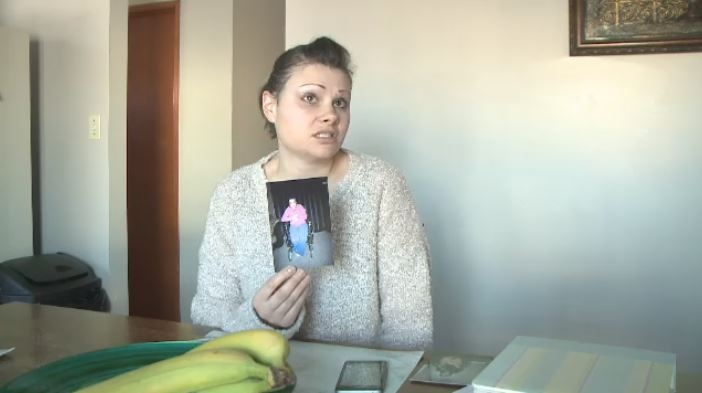 Jessie Veeman holds a photo of her daughter, Daisy Smee, who broke her hip in an accident in 2010
