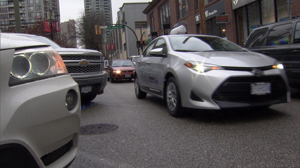 Parked cars are seen in Yaletown on Tuesday, Feb. 6, 2018.