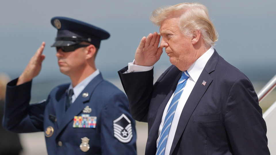 U.S. President Donald Trump returns a salute upon his arrival at Hagerstown Regional Airport in Hagerstown, Md. on Friday, Aug. 18, 2017. (Pablo Martinez Monsivais/AP Photo)