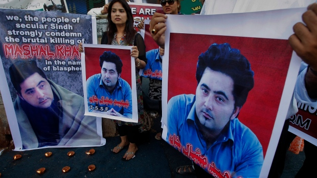 In this April 22, 2017 file photo, members of a Pakistani civil society group demonstrate against the killing of an university student Mohammad Mashal Khan, in the northwestern city of Mardan, in Karachi, Pakistan. (AP Photo/Fareed Khan, File)