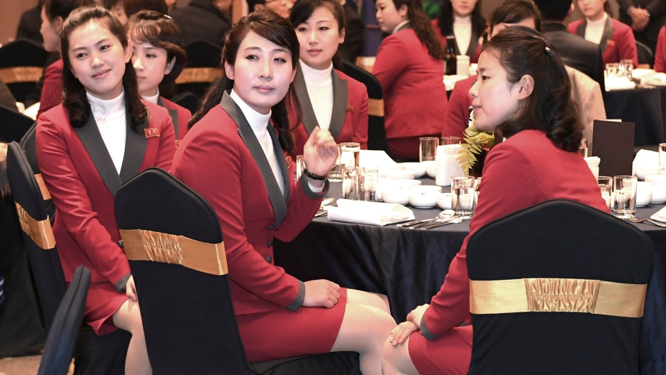 In this photo provided by South Korea Unification Ministry, North Korean cheering squads attend an official dinner in Inje, South Korea, Wednesday, Feb. 7, 2018. (South Korea Defense Ministry via AP)