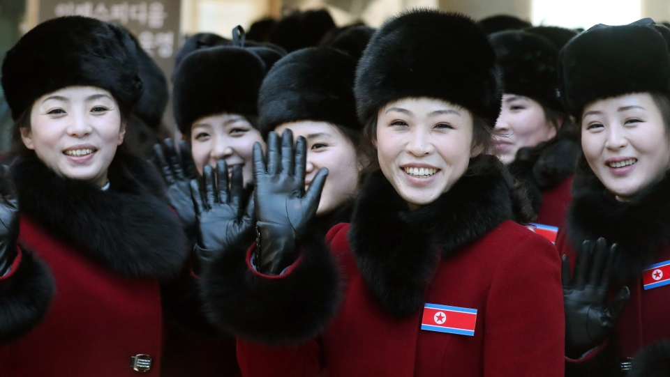 North Korean cheering squads wave upon their arrival at a stadium in Inje, South Korea, Wednesday, Feb. 7, 2018. (Yang Yong-suk/Yonhap via AP)