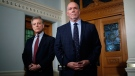Premier John Horgan and Minister of Environment and Climate Change Strategy George Heyman answer questions about the Alberta dispute during a press conference at the Legislature in Victoria, B.C., on Wednesday, Feb. 7, 2018. THE CANADIAN PRESS/Chad Hipolito