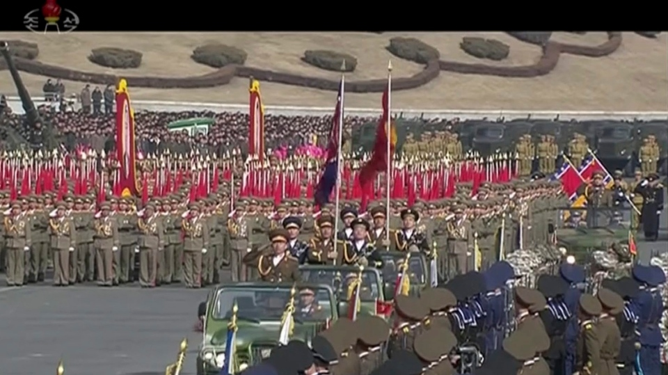 In this image made from video by North Korea's KRT, a military parade is held in Pyongyang, North Korea Thursday, Feb. 8, 2018. North Korea held the military parade and rally on Kim Il Sung Square on Thursday, just one day before South Korea hosts the opening ceremony of the Pyeongchang Winter Olympics. (KRT via AP Video)