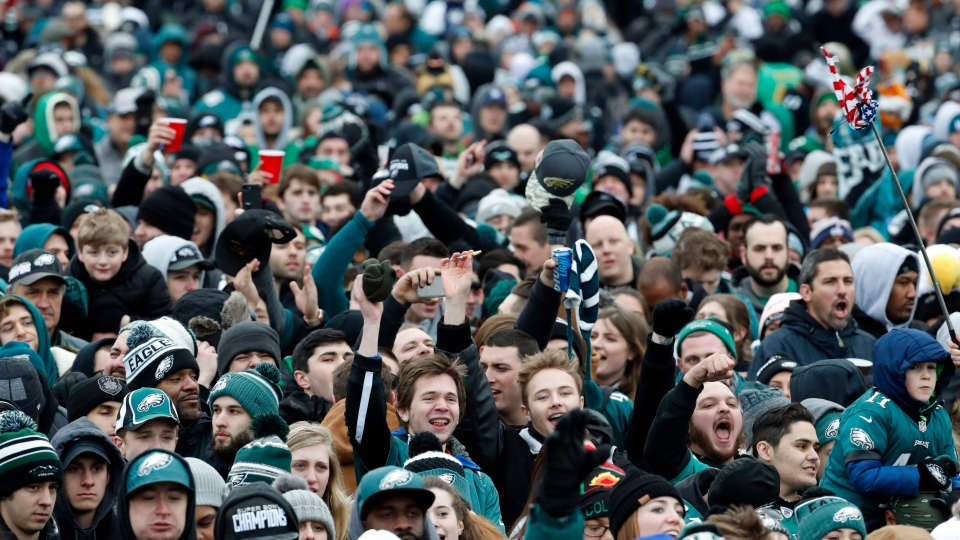 Fans cheer as they watch a replay of Super Bowl 52 in front of the the Philadelphia Museum of Art before a Super Bowl victory parade for the Philadelphia Eagles NFL football team, Thursday, Feb. 8, 2018, in Philadelphia. (AP Photo/Alex Brandon)