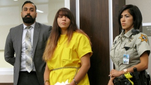 In this July 28, 2017 file photo, Obdulia Sanchez appears in a Los Banos, Calif., branch of the Merced County Superior Court with her public defender, Ramnik Samrao, left. (AP Photo/Scott Smith, File)
