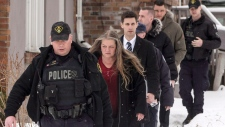 Forensic Anthropologist Professor Kathy Gruspier (second left) is seen on Thursday, February 8, 2018, with police officers at a Toronto property where alleged serial killer Bruce McArthur worked. THE CANADIAN PRESS/Chris Young