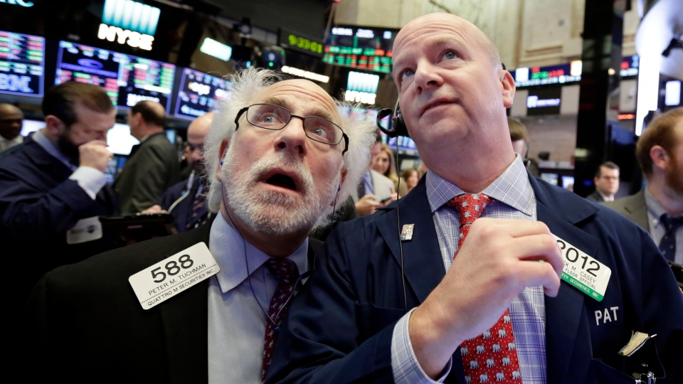 Traders Peter Tuchman, left, and Patrick Casey work on the floor of the New York Stock Exchange, Thursday, Feb. 8, 2018. (AP Photo/Richard Drew)