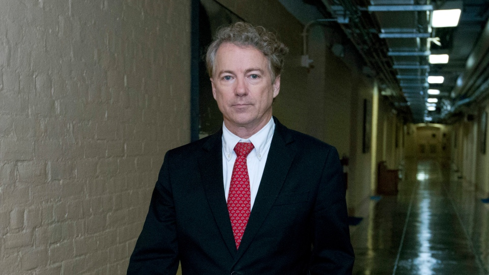 U.S. Sen. Rand Paul, R-Ky., walks to his office after speaking in the senate floor, at the Capitol, Thursday, Feb. 8, 2018, in Washington. (AP Photo/Jose Luis Magana)