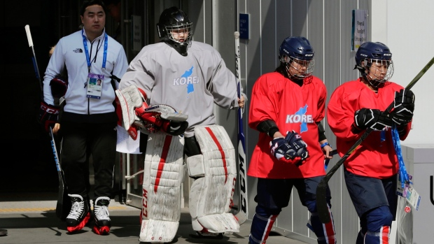 Members of the combined Koreas women's hockey team