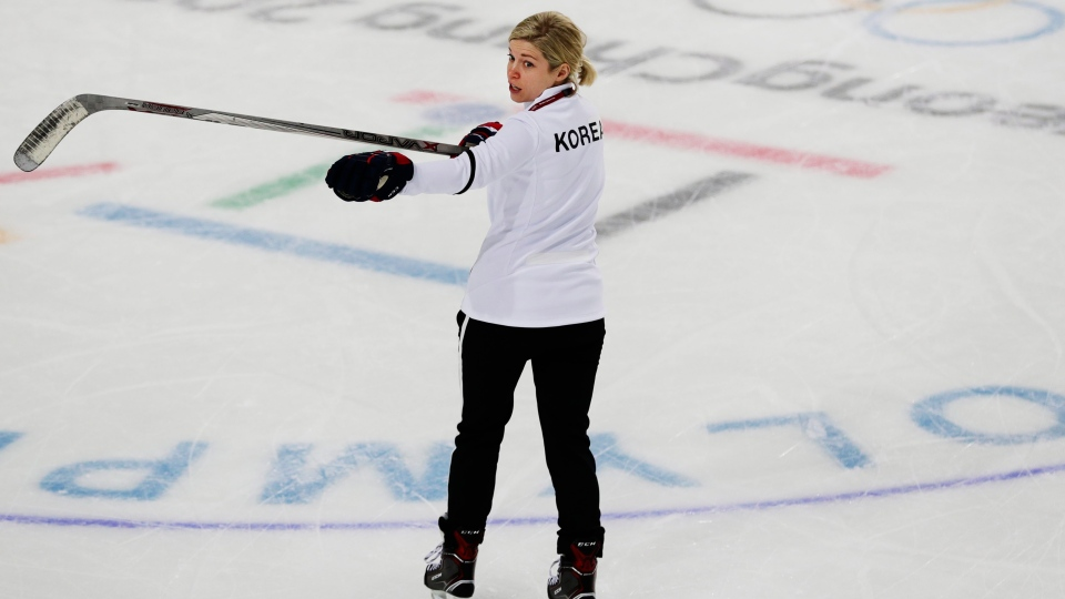 Sarah Murray, one of the coaches of the combined Koreas women's hockey team, speaks to players during a practice session prior to the 2018 Winter Olympics in Gangneung, South Korea, Friday, Feb. 9, 2018. (AP / Frank Franklin II)