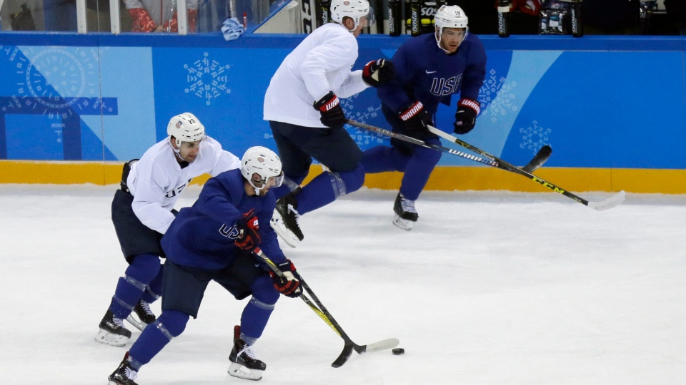 United States' Ryan Gunderson battles controls the puck against Mark Arcobello, left, during practice ahead of the 2018 Winter Olympics in Gangneung, South Korea, Friday, Feb. 9, 2018. (AP / Kiichiro Sato)