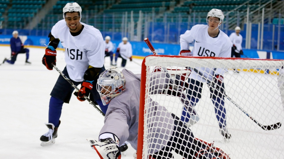 United States' goalie Brandon Maxwell reaches for a puck as Jordan Greenway, left, and Ryan Donato watch during practice ahead of the 2018 Winter Olympics in Gangneung, South Korea, Friday, Feb. 9, 2018. (AP / Kiichiro Sato)