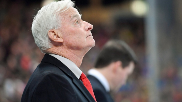 Team Canada's assistant coach Dave King looks up,