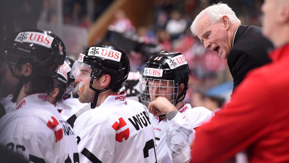 Dave King, right, talks to players, during the game between Dinamo Minsk and Team Canada, at the 90th Spengler Cup hockey tournament in Davos, Switzerland, Monday, Dec. 26, 2016. (THE CANADIAN PRESS / AP-Keystone, Melanie Duchene)