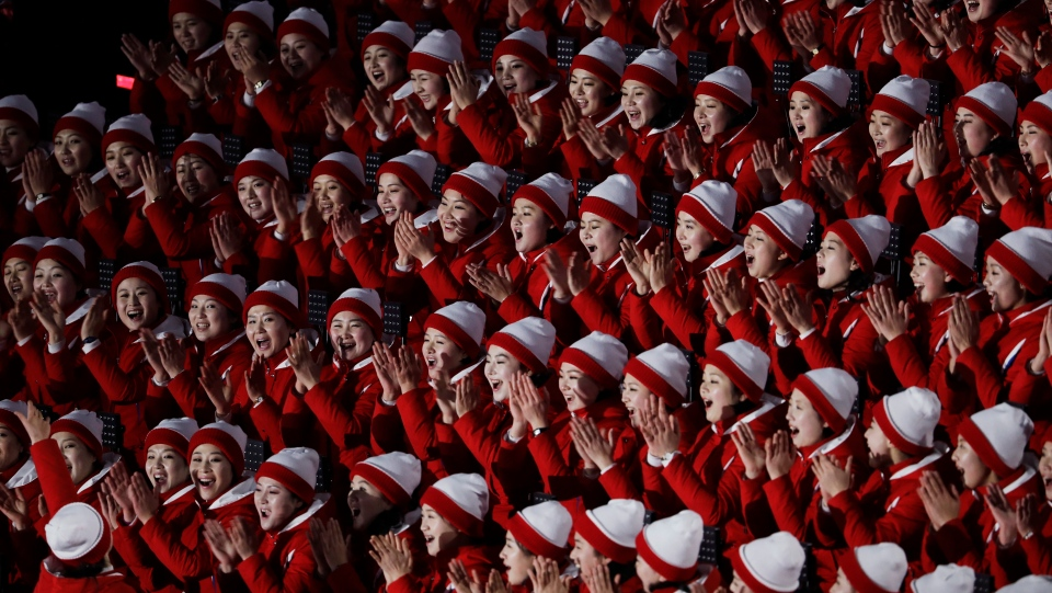 Members of the North Korean delegation gesture before the opening ceremony of the 2018 Winter Olympics in Pyeongchang, South Korea, Friday, Feb. 9, 2018. (AP Photo/Natacha Pisarenko)