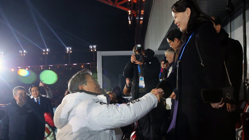 South Korean President Moon Jae-in, left, shakes hands with North Korean leader Kim Jong Un's younger sister Kim Yo Jong during the opening ceremony of the 2018 Winter Olympics in Pyeongchang, South Korea, Friday, Feb. 9, 2018. (Kim Ju-sung/Yonhap)