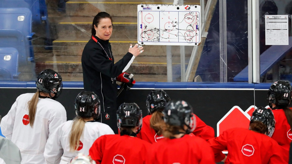 Canadian head coach Laura Schuler talks with the team in preparation for the IIHF Women's World Championship hockey tournament, Thursday, March 30, 2017, in Plymouth, Mich. (AP / Paul Sancya)