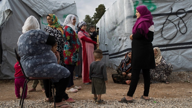 Syrian women with their children speak