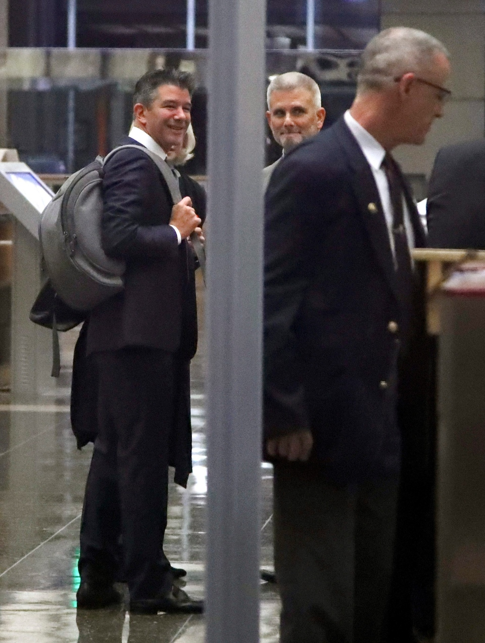 Former Uber CEO Travis Kalanick, left, goes through a security line upon entering a federal courthouse on Wednesday, Feb. 7, 2018, in San Francisco. (AP / Ben Margot)