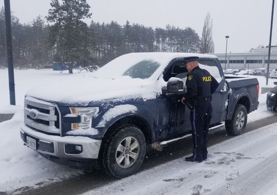 Norfolk OPP provided this photo of a motorist with only a portion of the windshield clear.
