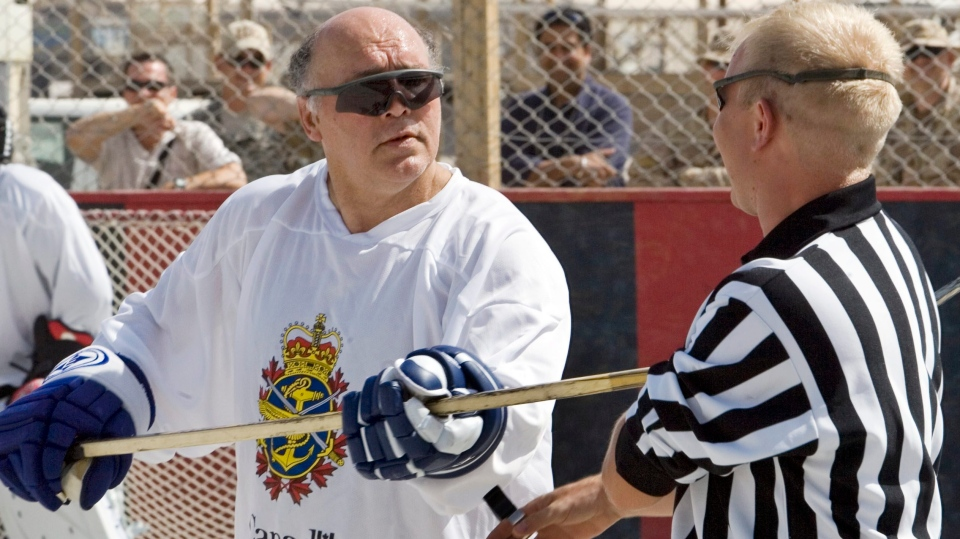 Legendary Toronto Maple Leafs enforcer Dave (Tiger) Williams jokingly takes a swing at referee Cpl. Mike Dobson, from Dartmouth, N.S., in Kandahar, Afghanistan, on Thursday, May 3, 2007.(CP PHOTO/Ryan Remiorz)