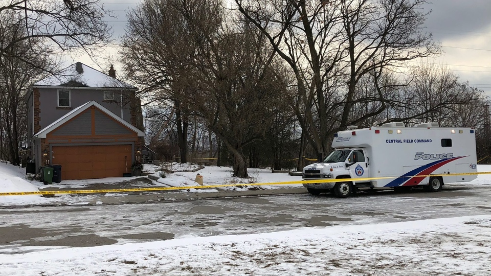 In this Saturday, Feb. 3, 2018 photo, crime scene tape surrounds a property where police say they recovered the remains of at least six people from planters on the property which is connected to alleged serial killer Bruce McArthur, in Toronto, Canada. (AP Photo / Rob Gilles)