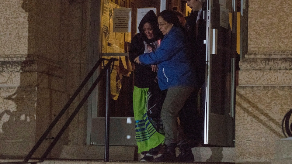 Debbie Baptiste, left, the mother of Colten Boushie, is supported outside the Court of Queen's Bench in Battleford, Sask., on Friday, Feb. 9, 2018, after a jury delivered a verdict of not guilty in the trial of Gerald Stanley, the farmer accused of killing the 22-year-old Indigenous man. THE CANADIAN PRESS/Liam Richards