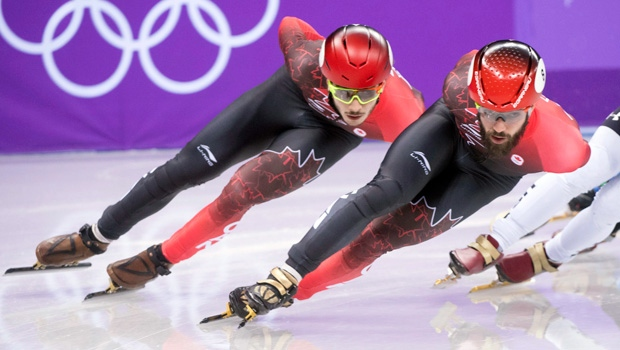 Charles Hamelin, right, and Samuel Girard compete in the men's 1500 metre semifinals at the 2018 Winter Olympics in Gangneung, South Korea, Saturday, February 10, 2018. THE CANADIAN PRESS/Paul Chiasson