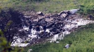 Israeli security stands around the wreckage of an F-16 that crashed in northern Israel, near kibbutz of Harduf, Saturday, Feb. 10, 2018. (AP Photo/Rami Slush)