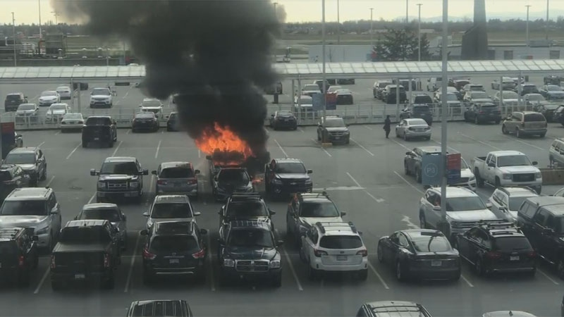 A vehicle on the top level of the YVR parkade caught fire on Saturday afternoon. (Benjamin Seagoat Hendricks)