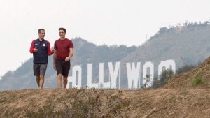 Prime Minister Justin Trudeau, right, and Los Angeles Mayor Eric Garcetti go for a hike during a visit to Griffith Park Saturday, February 10, 2018 in Los Angeles. (THE CANADIAN PRESS / Ryan Remiorz)